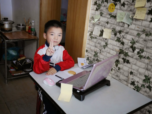 boy using a laptop at the Black Tide (黑潮) cafe