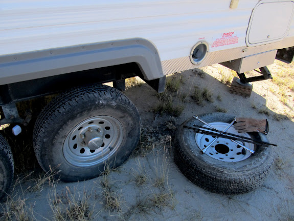 Changing a flat tire on the trailer Wednesday morning