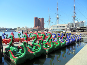 sea serpent paddleboats with the USS Constellation Inner Harbor Baltimore Maryland