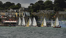 J/80 sailboats- starting off Royal Yacht Squadron, Cowes, Isle of Wight, England