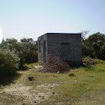 Historic concrete building on coast cemetery trail (17973)