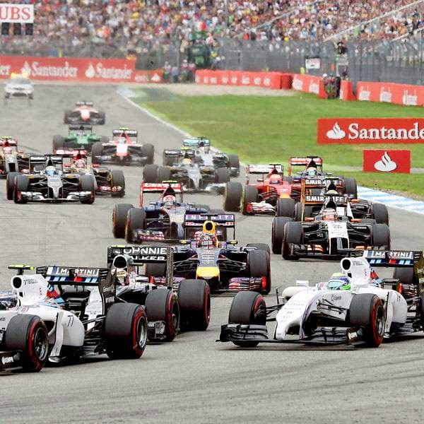 Pilots drive on the circuit after the start of the race at the German Formula One Grand Prix at the Hockenheimring racing circuit in Hockenheim, southern Germany, on July 20, 2014.