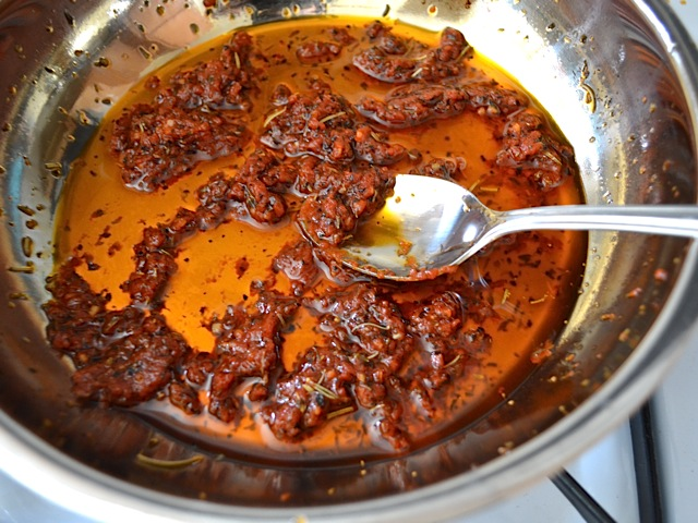 tomato paste added to sauce in skillet