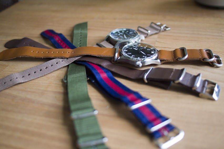 Various NATO-style straps of nylon and leather.