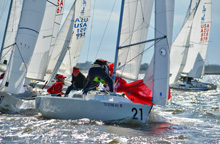 J/22s sailboats- sailing past mark