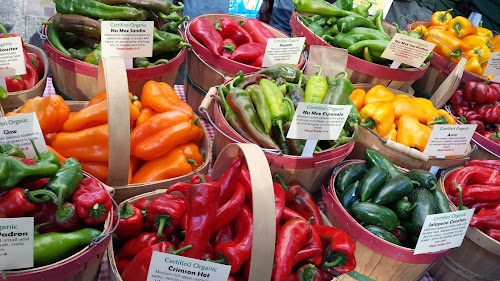 Organic Roasted Chli Peppers from Westwind Gardens, Forest Grove, OR at Portland Farmers Market PSU in autumn. The aroma of the freshly roasting peppers is incredible