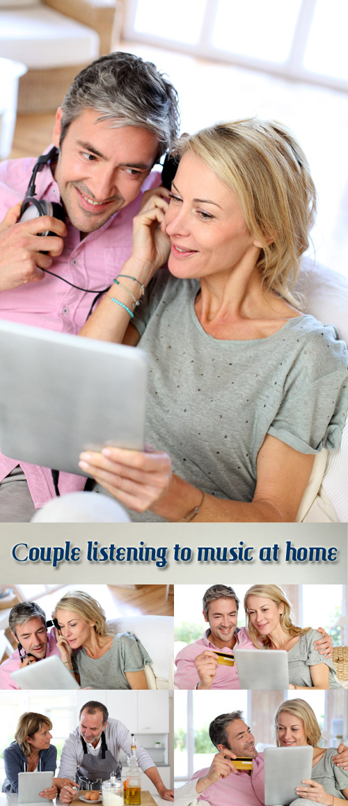 Stock Photo: Couple listening to music at home with tablet