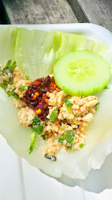 Laap Gai. This is a dish of minced chicken that you eat in lettuce wraps and can adorn with cucumber, a pinch of sticky rice, and a little scoop of jaew bawng (a dark thick reddish paste made from chiles and galangal root) from Haan Ghin, a Laotian Food Cart in Portland