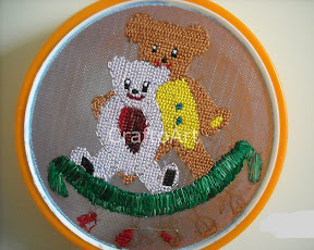 Cross stitch embroidery in a sieve
