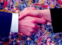 Hand shake against a back drop of Australian bank notes