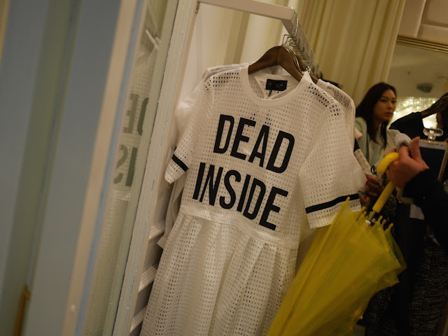 "dress with ""DEAD INSIDE"" written in large block characters"