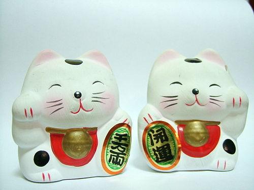 Maneki-neko o gato de la suerte. Fiel Mascota