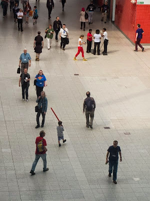 LonCon crowd with tiny light sabre wielder