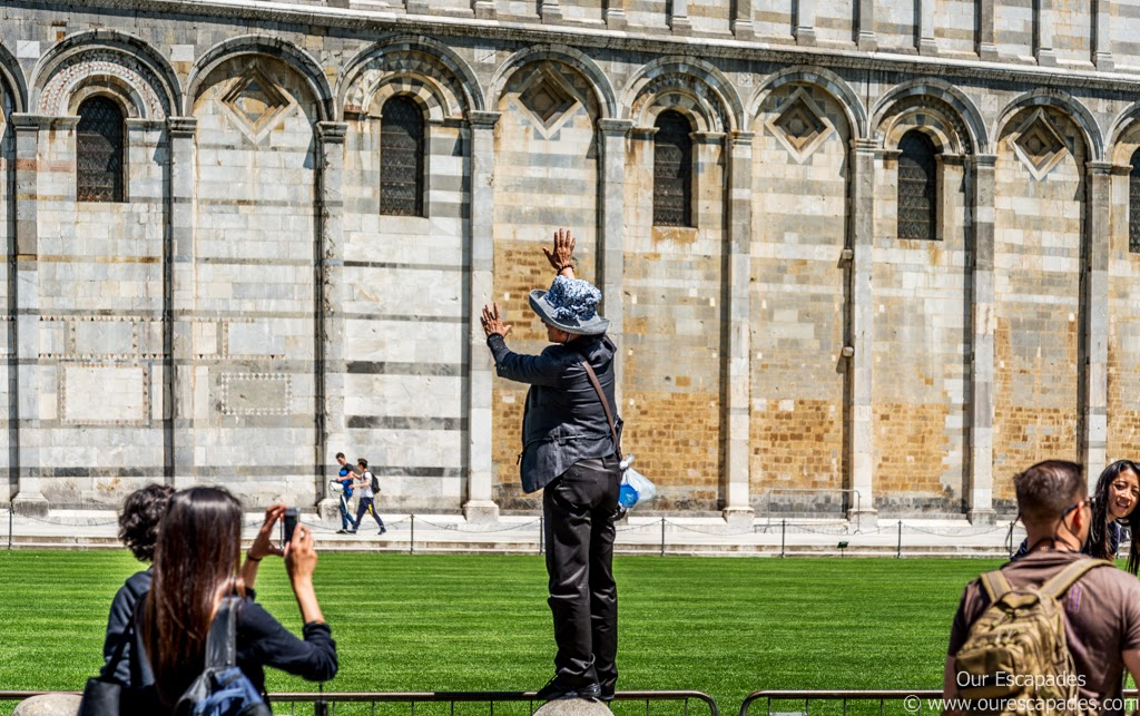 People taking pictures near the Leaning Tower of Pisa