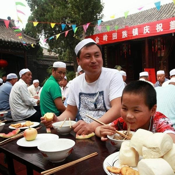 Chinese Muslims enjoy festive foods as they celebrate Eid al-Fitr at a mosque in Zibo, in eastern China's Shandong province.