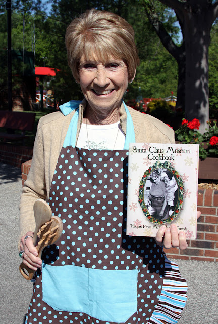 Mrs. Koch proudly displays the Santa Claus Museum Cookbook