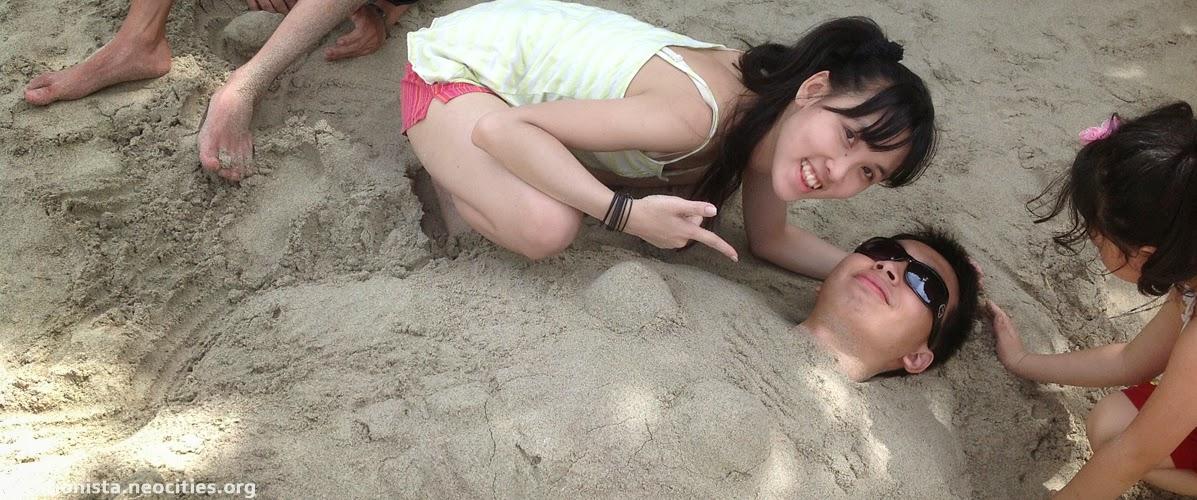 Alexia buried Luke in the sand