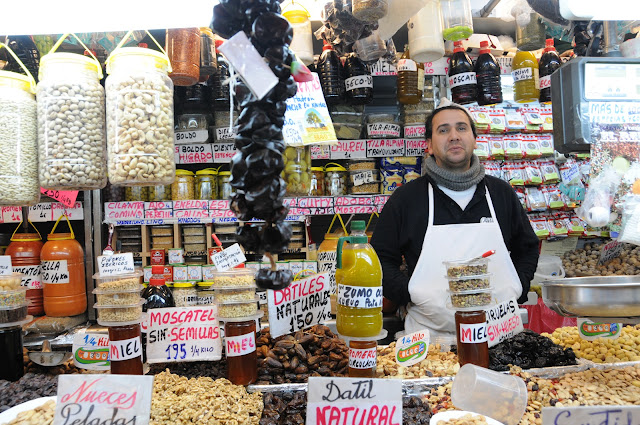 Malaga covered market, dried fruit and spice vendor, spain