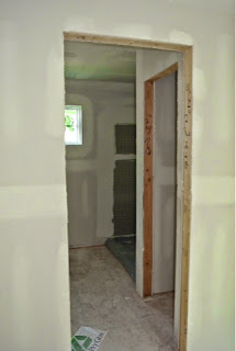 Picture of the master bathroom as viewed through the doorway just after drywall installed