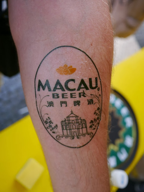 Macau Beer temporary tattoo on an arm