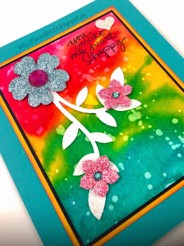 Linda Vich Creates: Watercolor Workout. Bold and vibrant watercolor background provides the ideal setting for sparkly Floral Frenzy leaves and a few punched flowers, colored with Blendabilities.