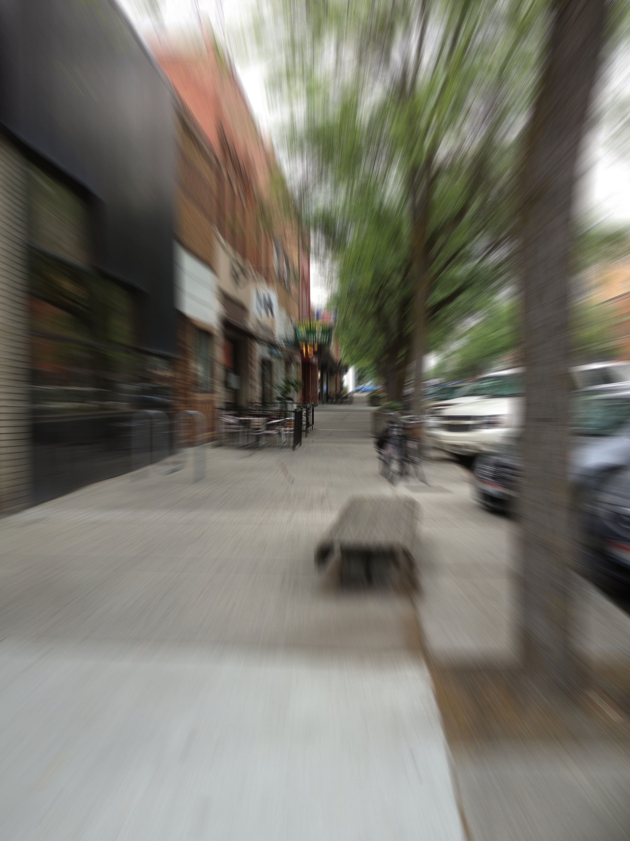 Same street scene, out of focus. A photo effect makes it look as if the scene is flickering or streaked toward the center of the picture.