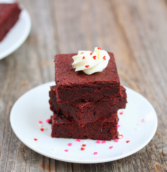 a stack of Red Velvet Brownies on a white plate