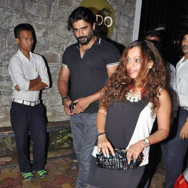 R Madhavan and his wife Sarita Birje snapped out side restaurant Lido, in Mumbai. The actor was joined by Bipasha Basu, Harman Baweja, Shilpa Shetty and Raj Kundra for a private dinner.(Pic: Viral Bhayani)