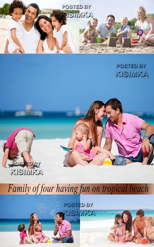 Stock Photo: Family of four having fun on tropical beach