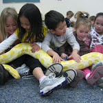 These preschoolers are enjoying the visit of a big snake--part of our series of in-house field trips.