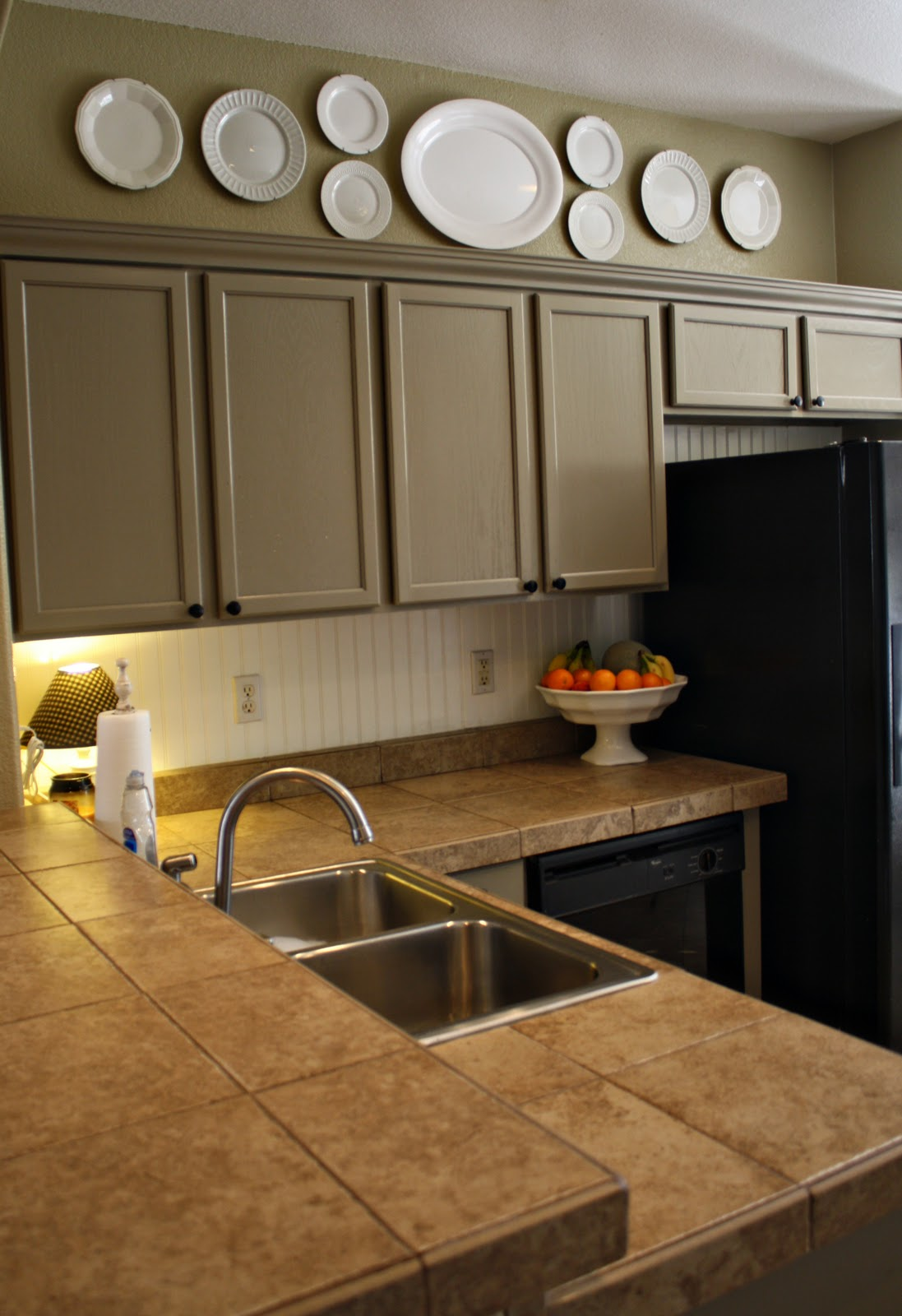 Design Rules You Can Break Above The Kitchen Cabinets