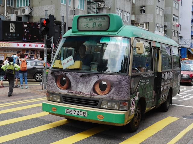 Hong Kong mini-bus with cat eyes on the front as part of an advertisement for the Shatin Animal Clinic