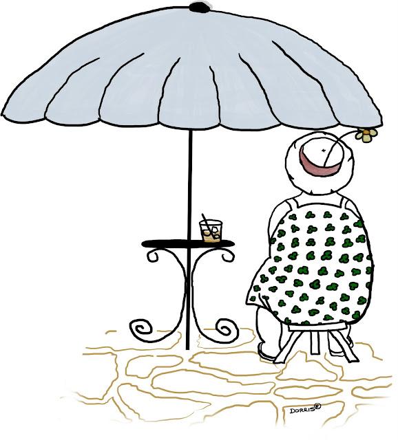 Dorris - sitting under an umbrella on her flagstone porch, enjoying a tasty beverage.
