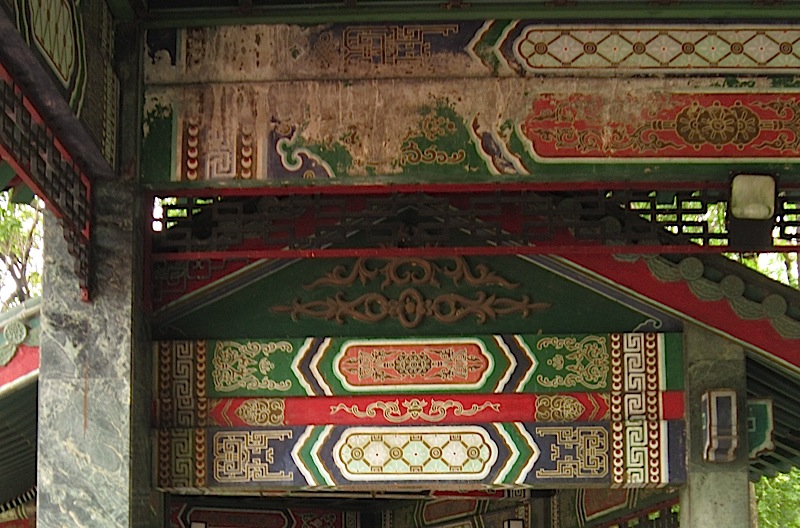 beams of Chinese pavilion at the Rizal Park with faded paintings