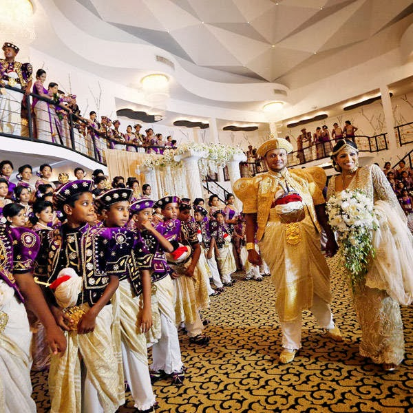 Sri Lankan couple Nalin, left, and Nisansala arrive for their wedding ceremony as they attempt to set a Guinness record for a wedding with the most number of bridesmaids for a bride in Negombo, on the outskirts of Colombo, Sri Lanka, Friday, Nov. 8, 2013.