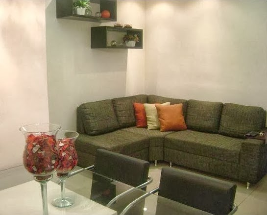 sala de estar com sofá de canto