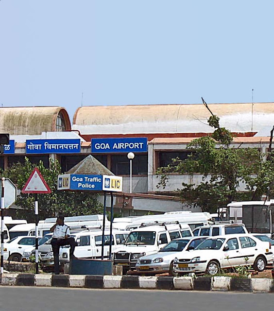 goa airport building and parked cars