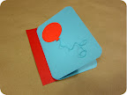 Use a glue stick to attach balloon to the front of your card. Tack the twine down in a few spots with dots of white glue.