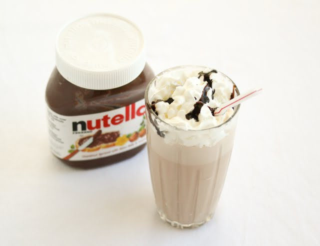 overhead photo of a nutella milkshake and a jar of nutella