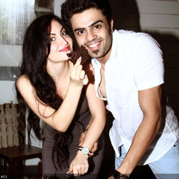 B'wood's foreign import Elli Avram during her b'day celebrations with Mickey Virus co-star Manish Paul, in Mumbai.