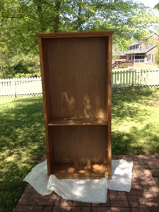 A brown IKEA Billy Bookcase before being painted