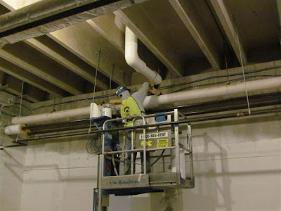 Pipe insulation being installed