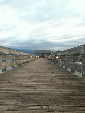 Comox Marina boardwalk lit up in evening light