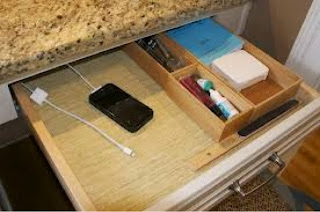Power strip, charges and devices hidden in drawer