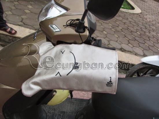 www.123nhanh.com: Gang tay xe máy chống rét