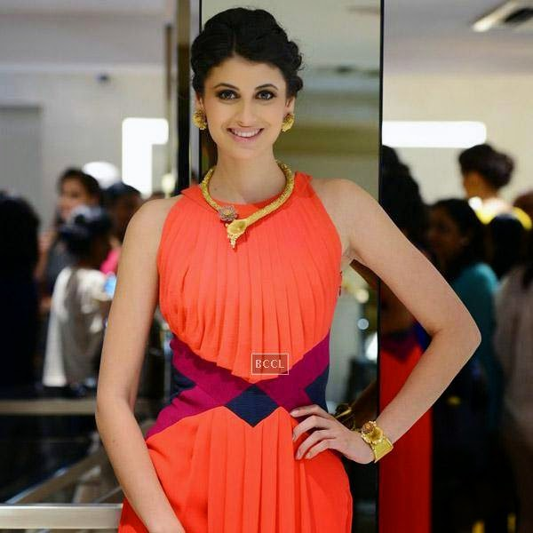 A model smiles for the cameras during a high tea hosted by Nisha Jamwal and Veda Raheja,  at Zoya on July 24, 2014.(Pic: Viral Bhayani)