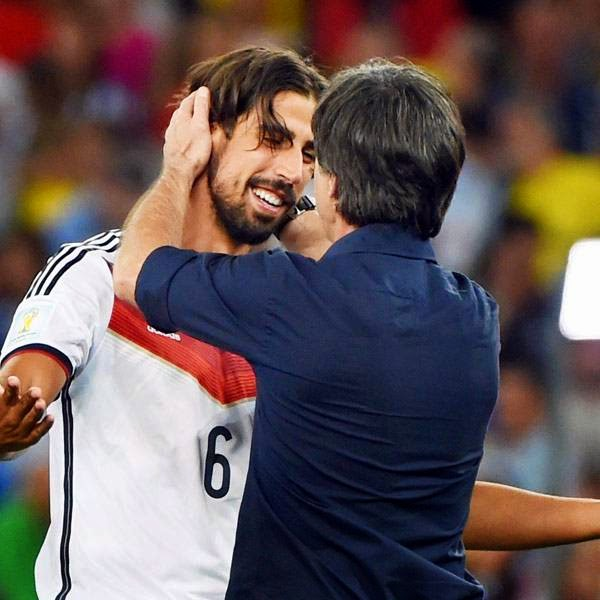 Germany's coach Joachim Loew (R) and Germany's midfielder Sami Khedira celebrate after winning the 2014 FIFA World Cup final football match between Germany and Argentina 1-0 following extra-time at the Maracana Stadium in Rio de Janeiro, Brazil, on July 13, 2014.