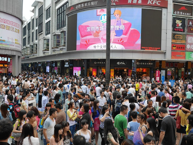 dense crowd at Dongmen in Shenzhen during Labour Day