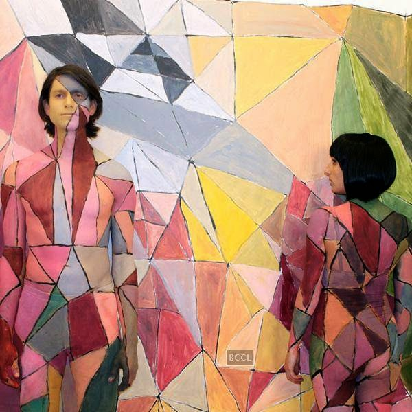 "Gotye and Kimbra, you can't count paint as clothing, right? Then Gotye and Kimbra earn a spot on this list for ""Somebody That I Used to Know."""