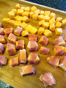 Prosciutto wrapped cantaloupe with red pepper lime oil and manchego recipe: wrapping the prosciutto around the cantaloupe pieces